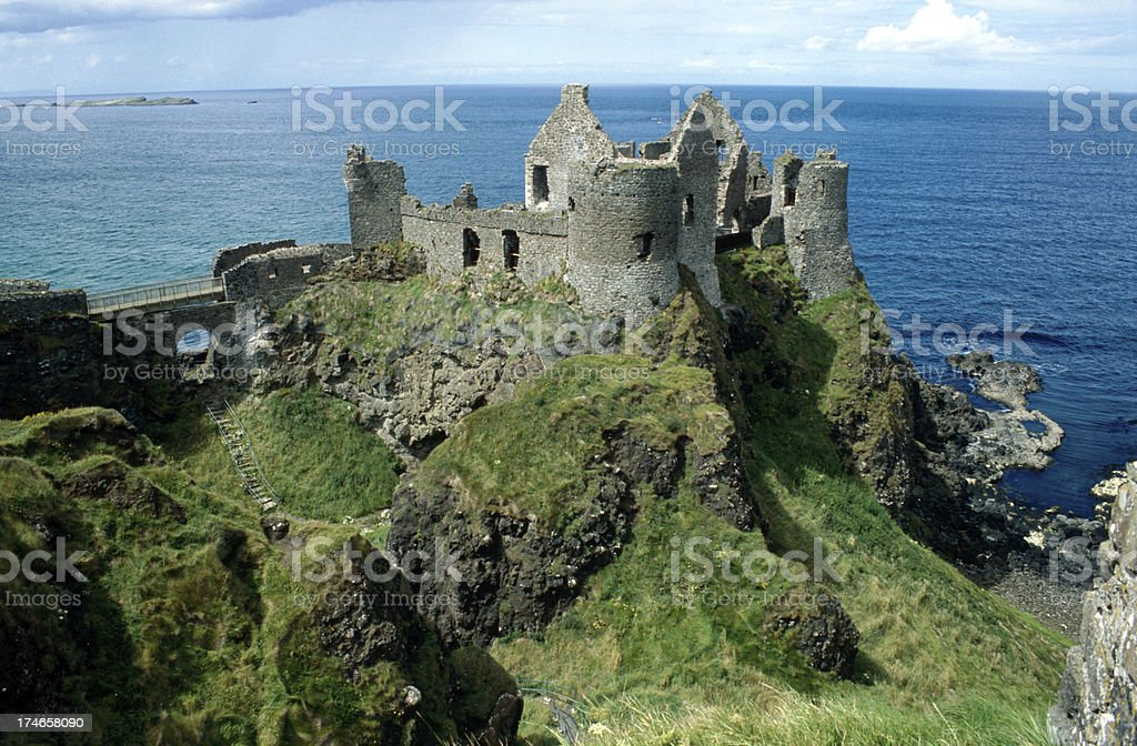 ancient Dunluce Castle on a cliff stock photo
