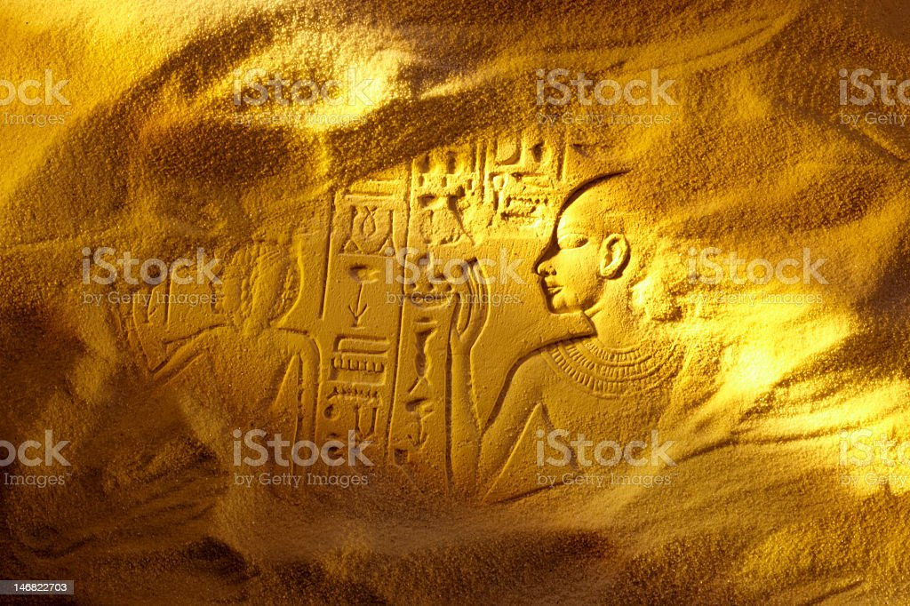 Ancient Egyptian hieroglyphs drawn in sand royalty-free stock photo