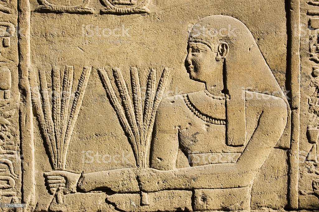 Ancient Egyptian Priest with Wheat stock photo