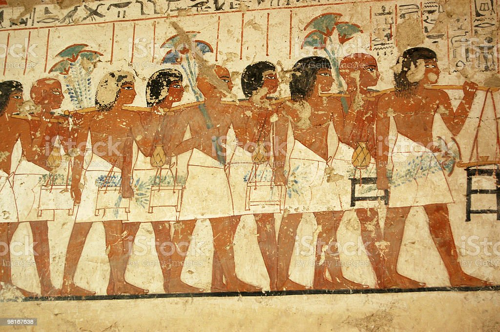 Ancient Egyptian tomb painting of people serving the pharaoh stock photo