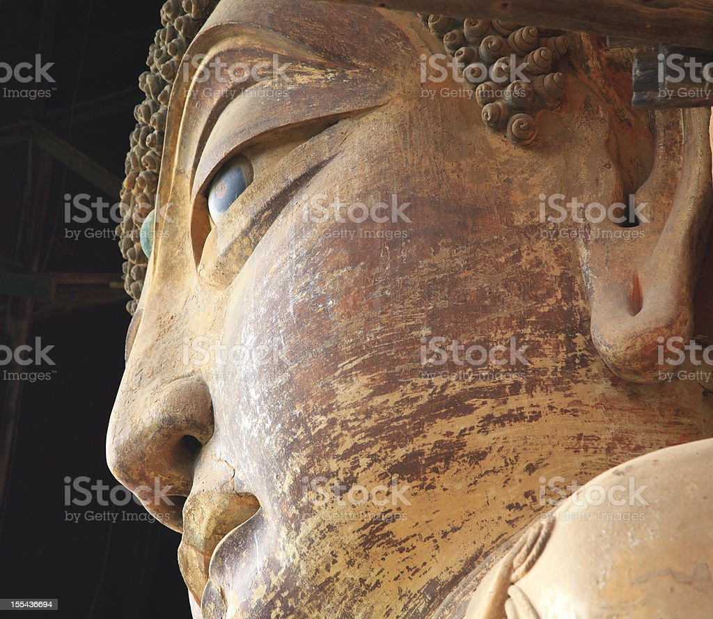 Ancient Famous buddha face of Maiji Mountain royalty-free stock photo