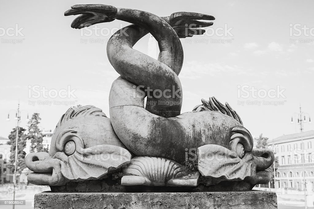 Ancient fish sculpture of Fontana del Nettuno stock photo