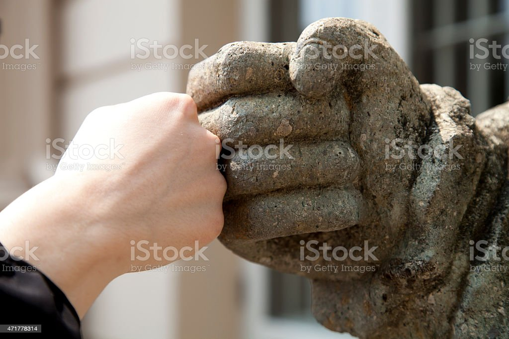 Ancient fist-bump stock photo