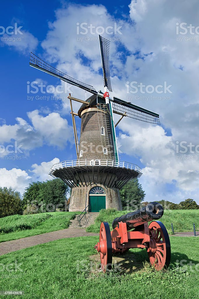 Ancient floor mill on city wall with red canon, Netherlands stock photo