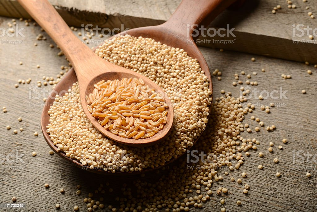 Ancient food grains on wood background royalty-free stock photo