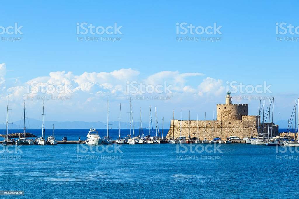 Ancient fortress at Mandraki Harbor, Rhodes, Greece stock photo