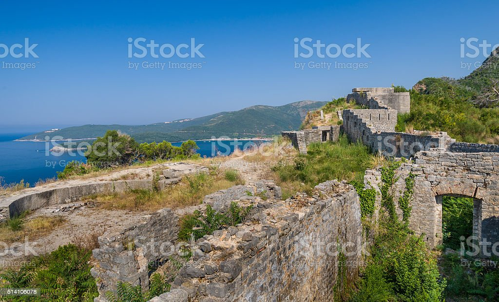 Ancient fortress walls on the shore of Adriatic sea stock photo