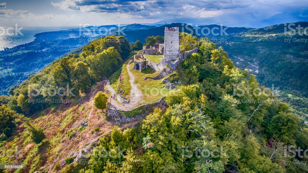 Ancient fortress with the remnants of the ruins on top of a mountain in New Athos, Abkhazia stock photo
