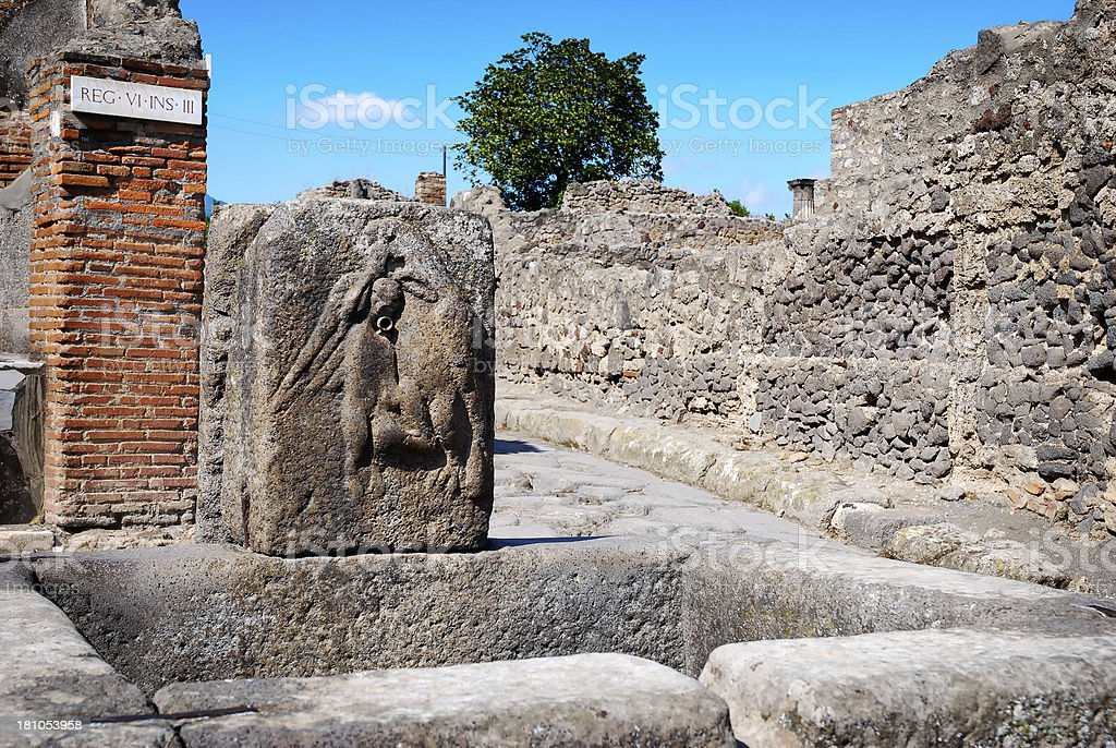 ancient fountain in the streets of Pompeii royalty-free stock photo