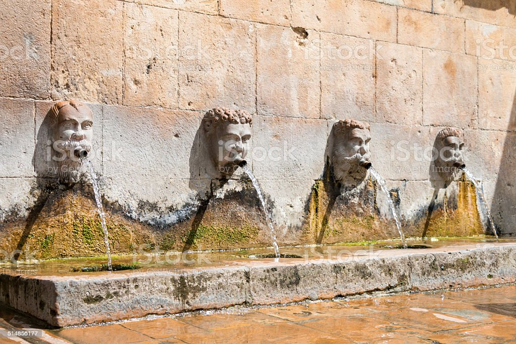 Ancient fountain stock photo