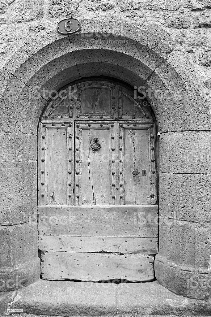 Antica porta in Pézenas francese foto stock royalty-free