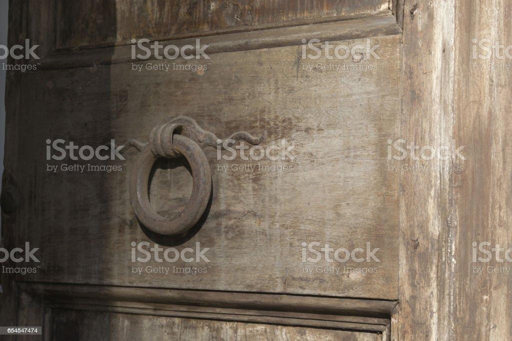 ancient front door with knocker stock photo
