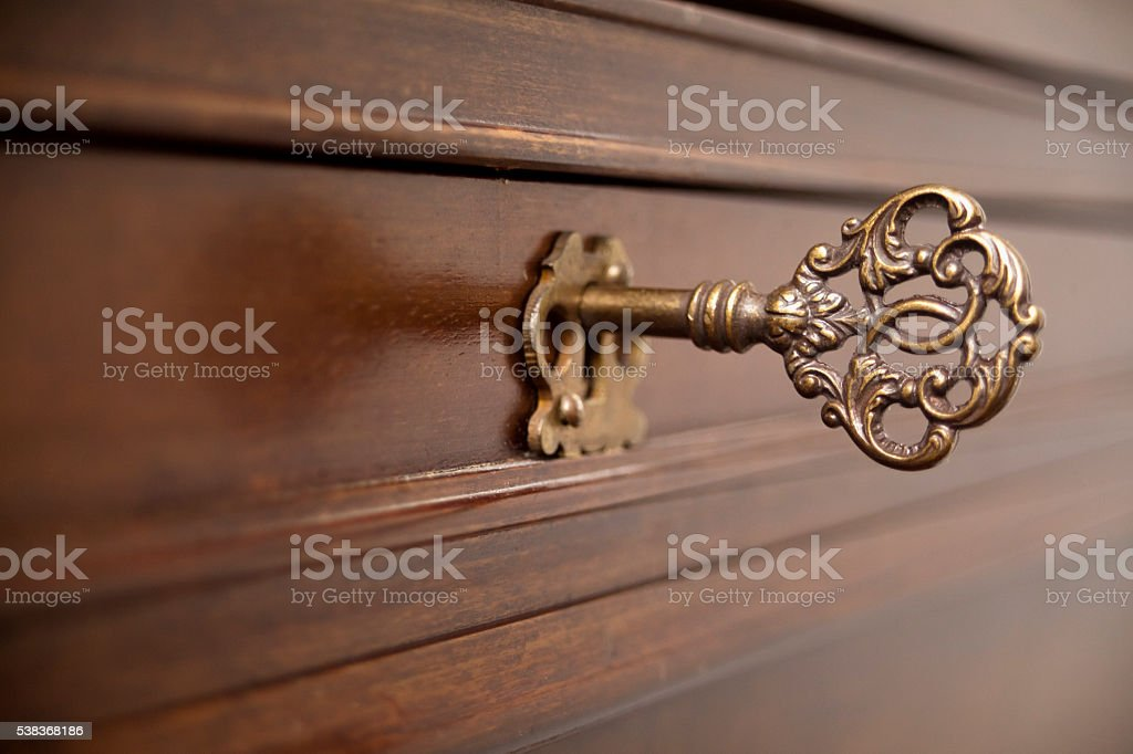 Ancient furniture lock, decorated key. stock photo