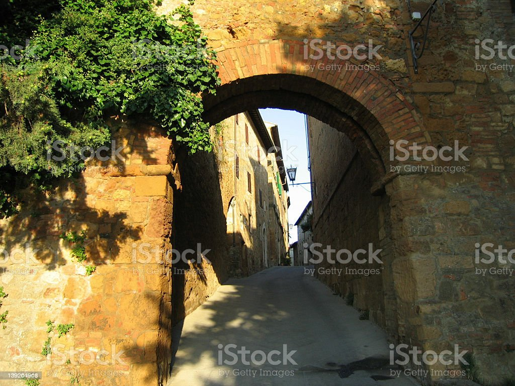 Ancient gate in Tuscan walls royalty-free stock photo