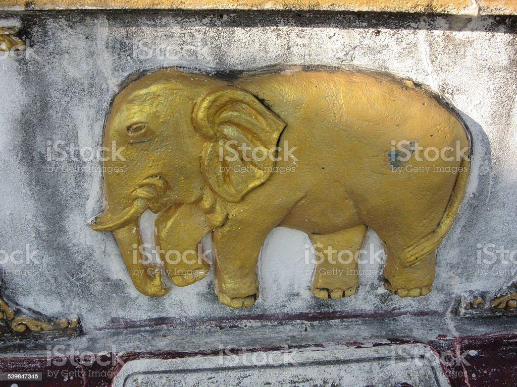Ancient Golden Elephant Carving, Bago, Myanmar stock photo