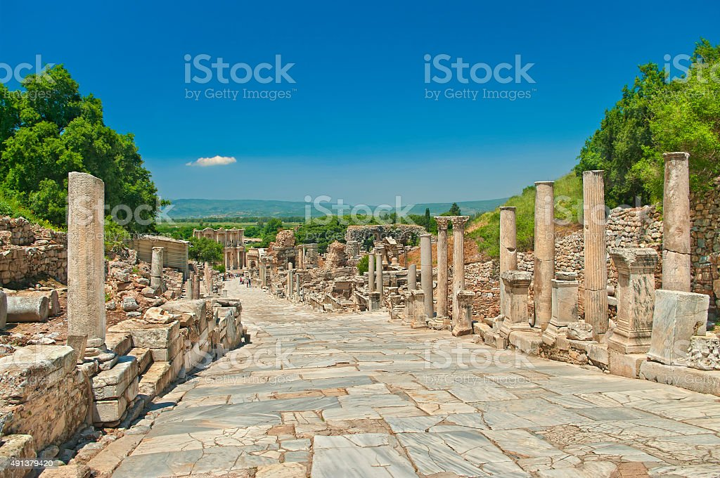 ancient greek alley with columns stock photo