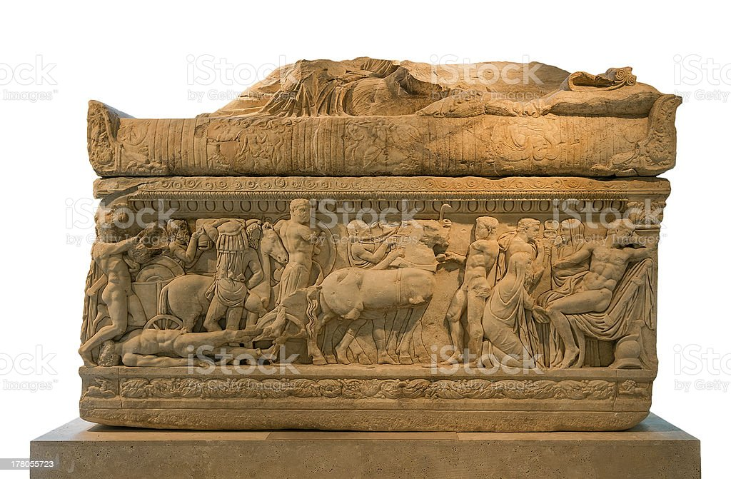 Ancient Greek sarcophagus decorated with scenes from Iliad, isolated stock photo