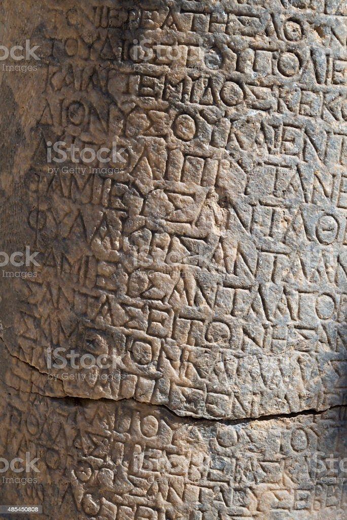 Ancient Greek Text on Lindos Acropolis Stones stock photo