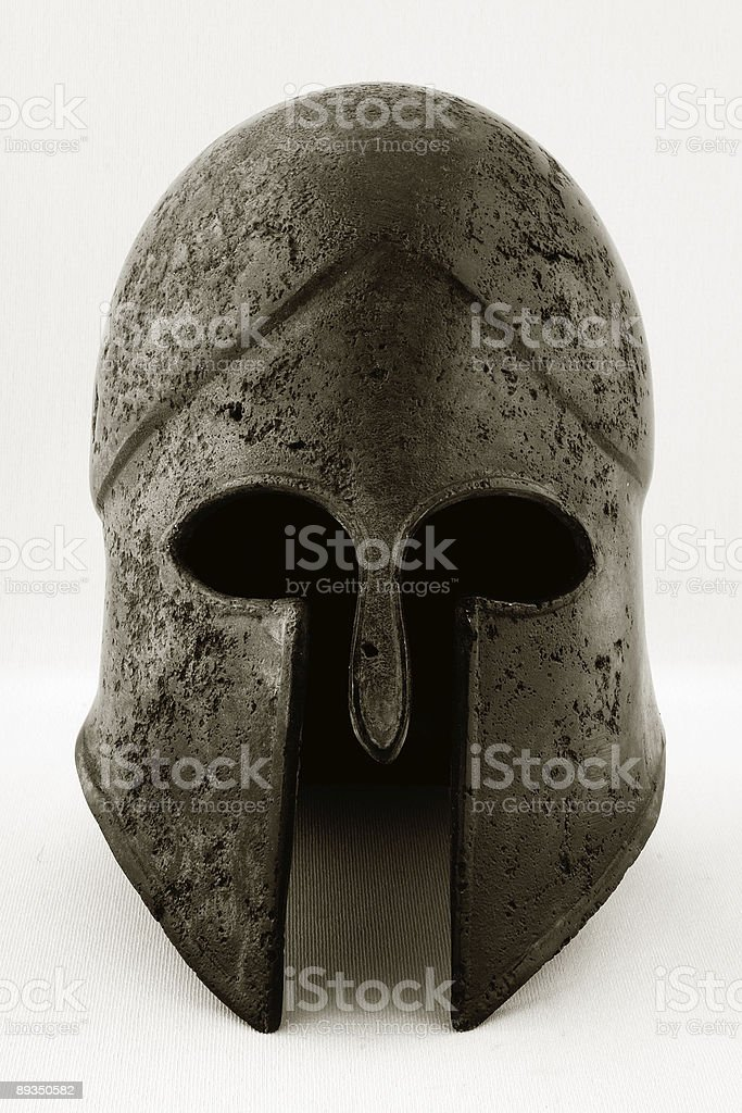 Ancient green Corinthian helmet stock photo