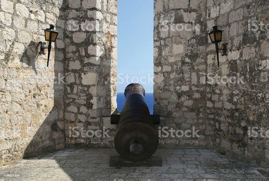 Ancient gun in the fortress protecting Hvar city . stock photo