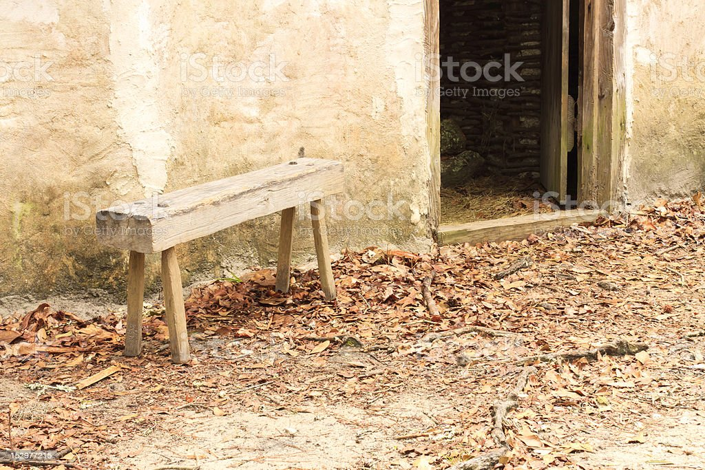 Ancient Handmade Bench Outside 18th Century Building stock photo