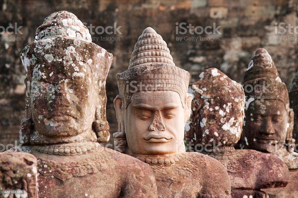Ancient heads of hindu gods at Angkor stock photo
