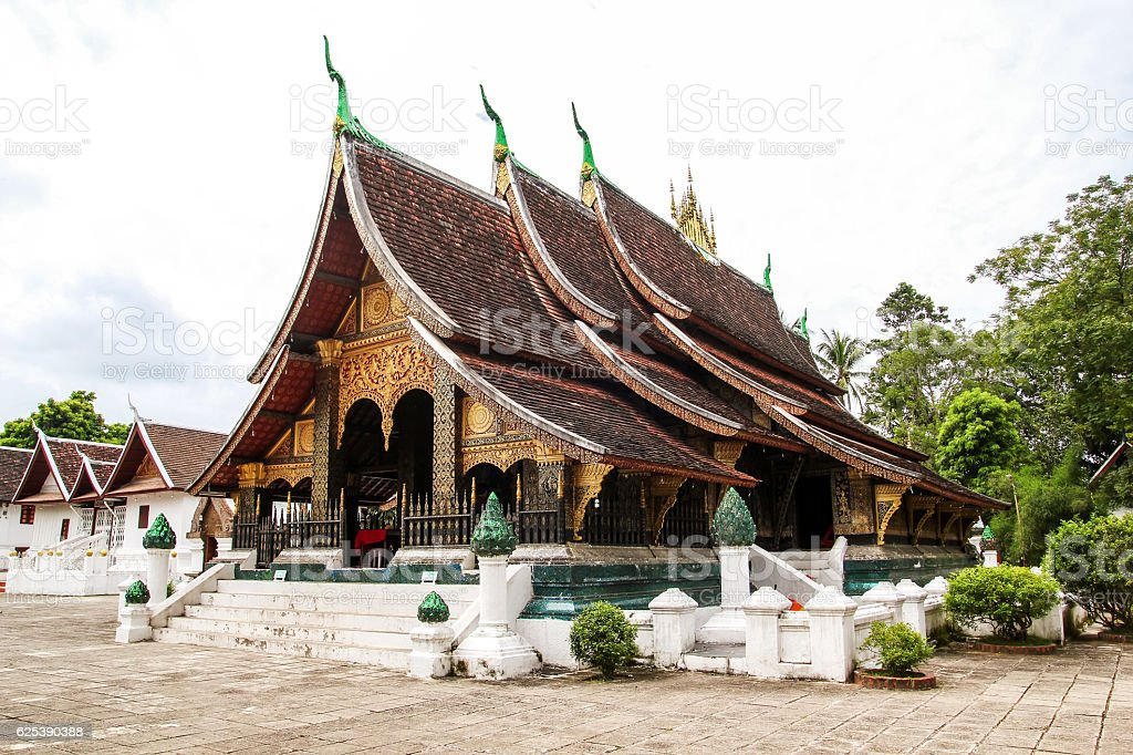 Ancient holy brown roof Laos style temple in Luang Prabang stock photo