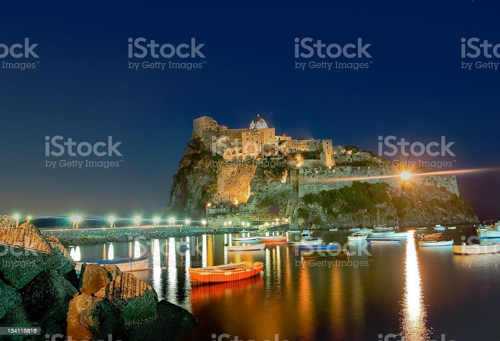 Ancient hotel and castle in Ischia island, Italy, at night stock photo