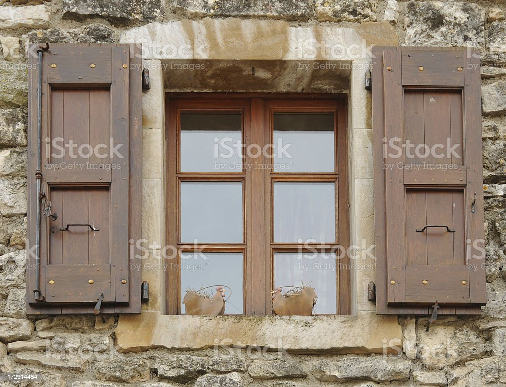 ancient house, window with brown shutters stock photo