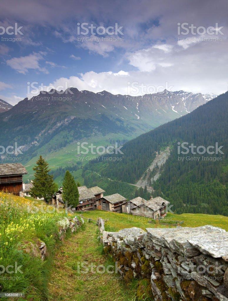 ancient hut in graubuenden-switzerland stock photo
