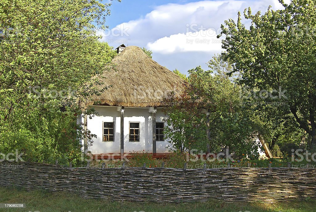 Ancient hut with a straw roof royalty-free stock photo