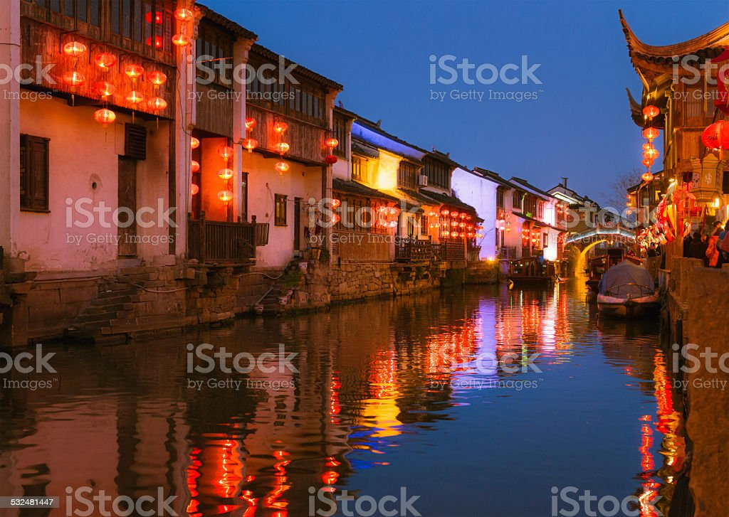 Ancient illuminated canal street in Suzhou, China stock photo