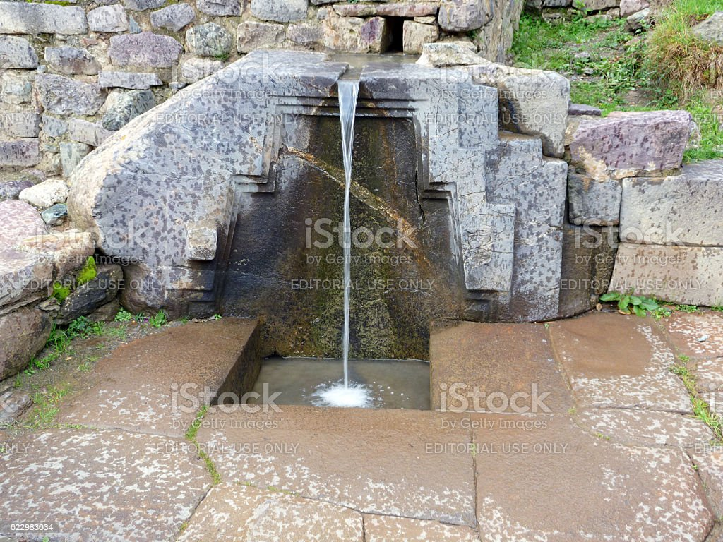 Ancient Inca fountain in Ollantaytambo stock photo