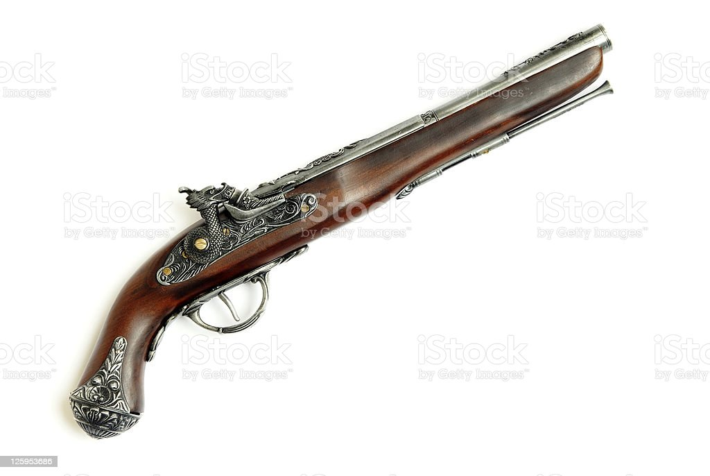 Ancient iron and wooden pistol stock photo