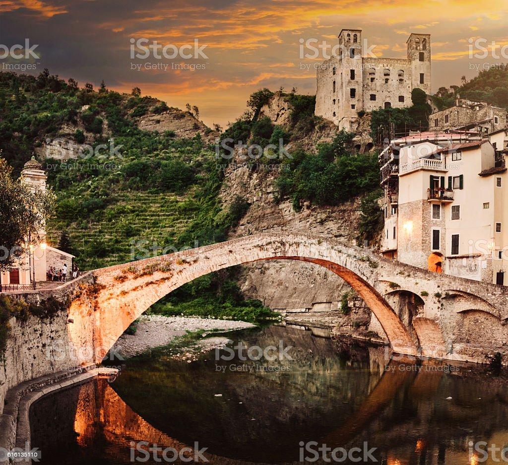 ancient Italian town with a Roman bridge and castle Dolceaqua stock photo