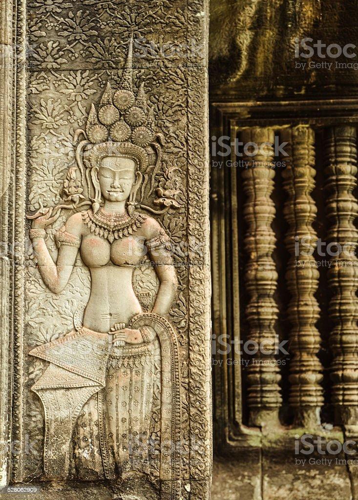 Ancient Khmer carving of Apsara dancing goddesses royalty-free stock photo