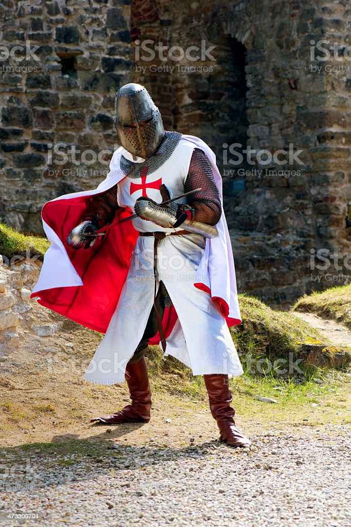 Ancient knight in armor stock photo