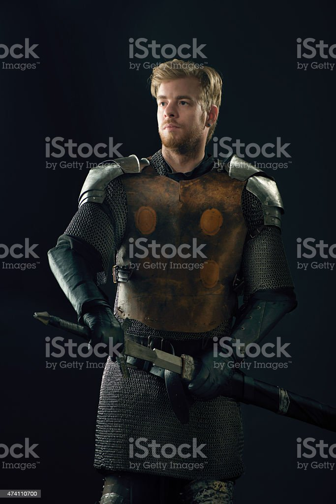 Ancient knight with sword stock photo
