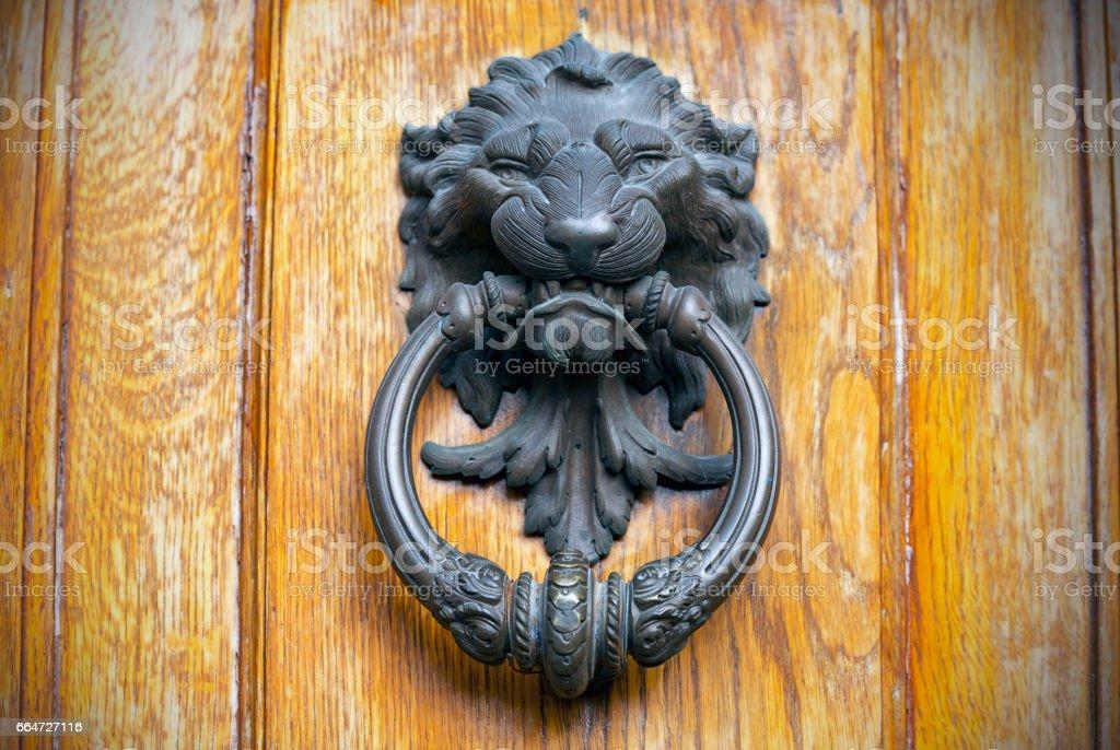 Ancient Knocker in Italy, Lion Head Door Knocker stock photo