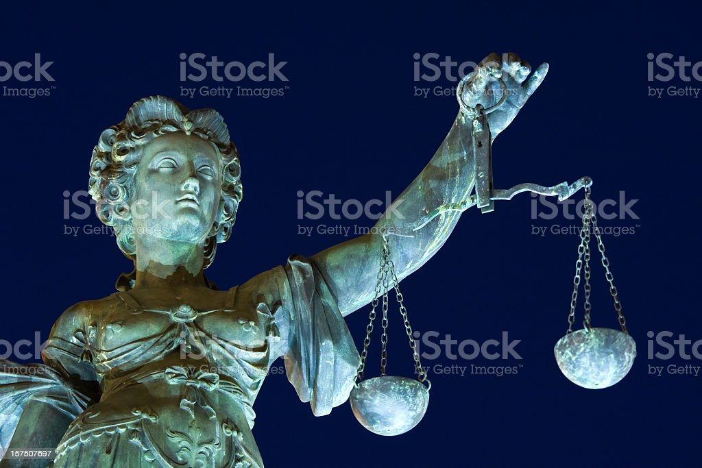 ancient Lady justice at night stock photo