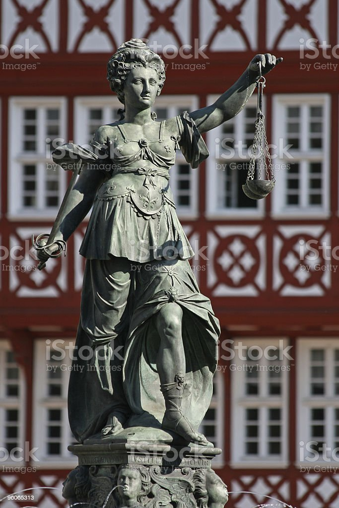 ancient Lady Justice statue full profile royalty-free stock photo