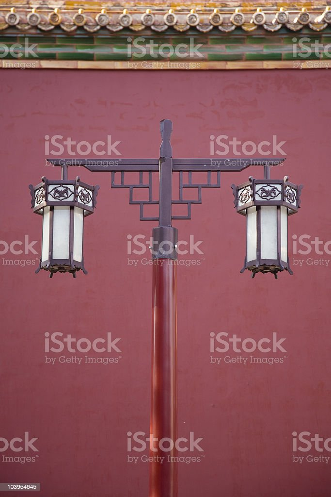 ancient lantern against red wall stock photo