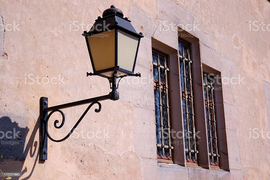 Ancient Lantern at a Church Facade royalty-free stock photo