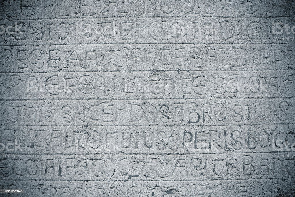 Ancient Latin Inscription Carved into Stone royalty-free stock photo