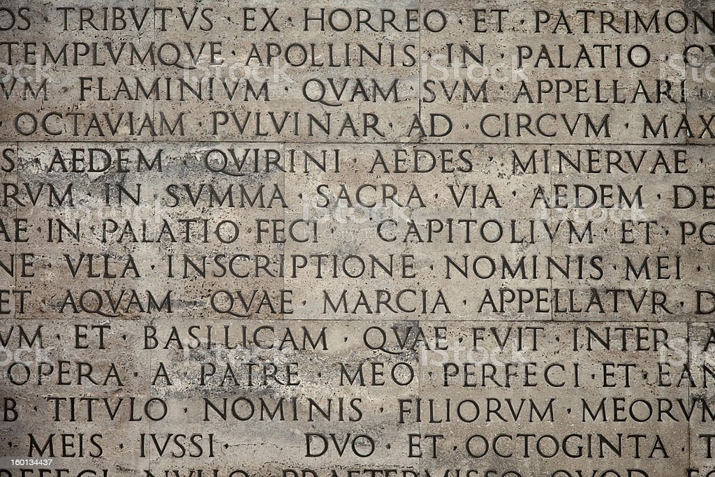 Ancient latin text carved on marble monument wall stock photo