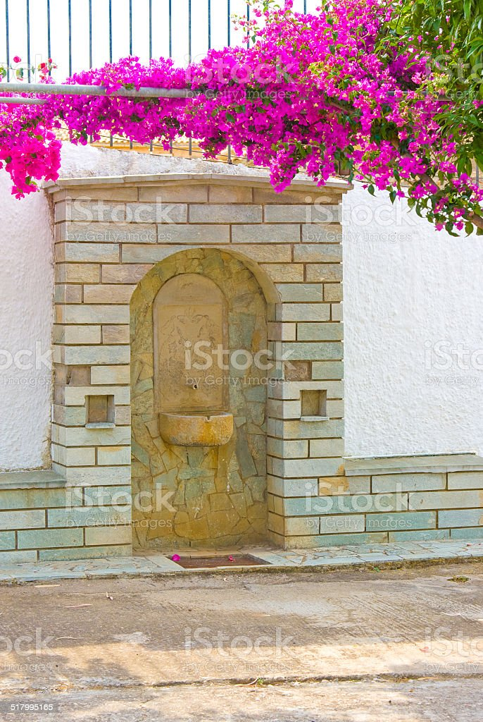 Ancient medieval sandstone drinking fountain. Peloponnese, Greece stock photo