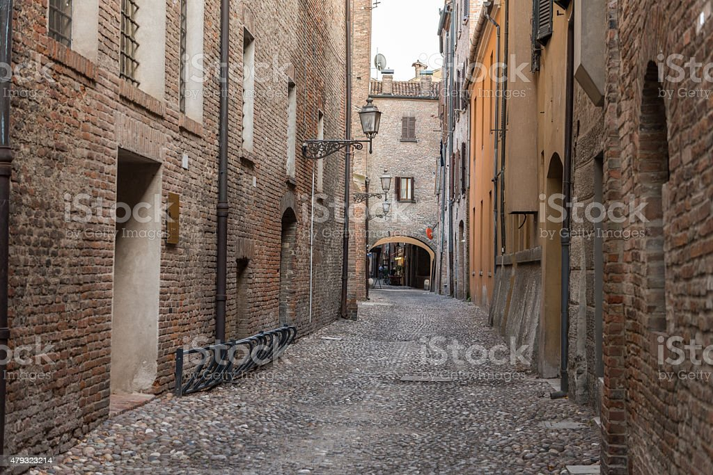 Ancient medieval street in the downtown of Ferrara city stock photo
