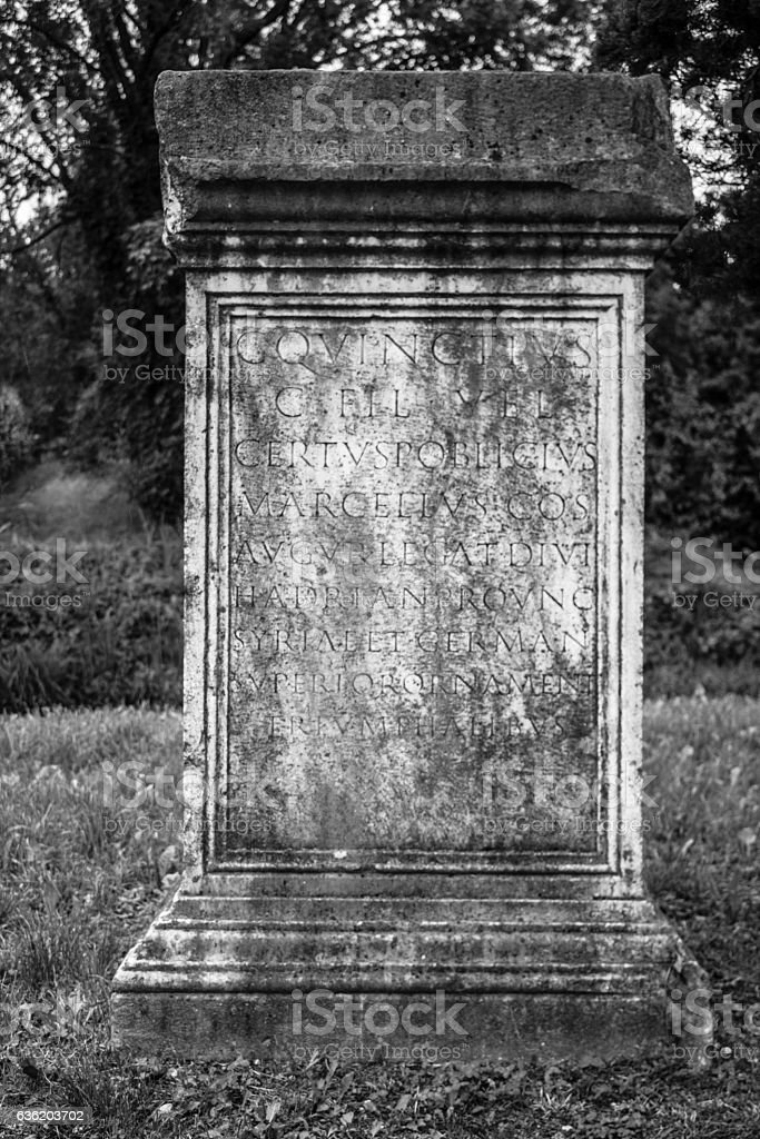 Ancient memorial with romanian writings, black and white stock photo