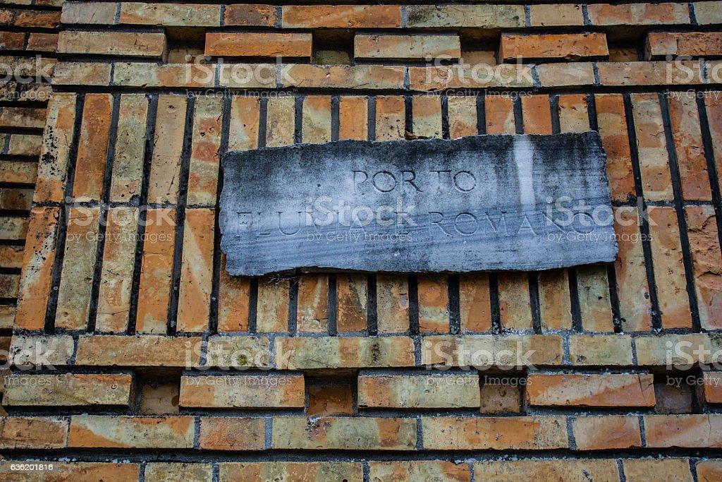 Ancient memorial with romanian writings, orange brick wall stock photo