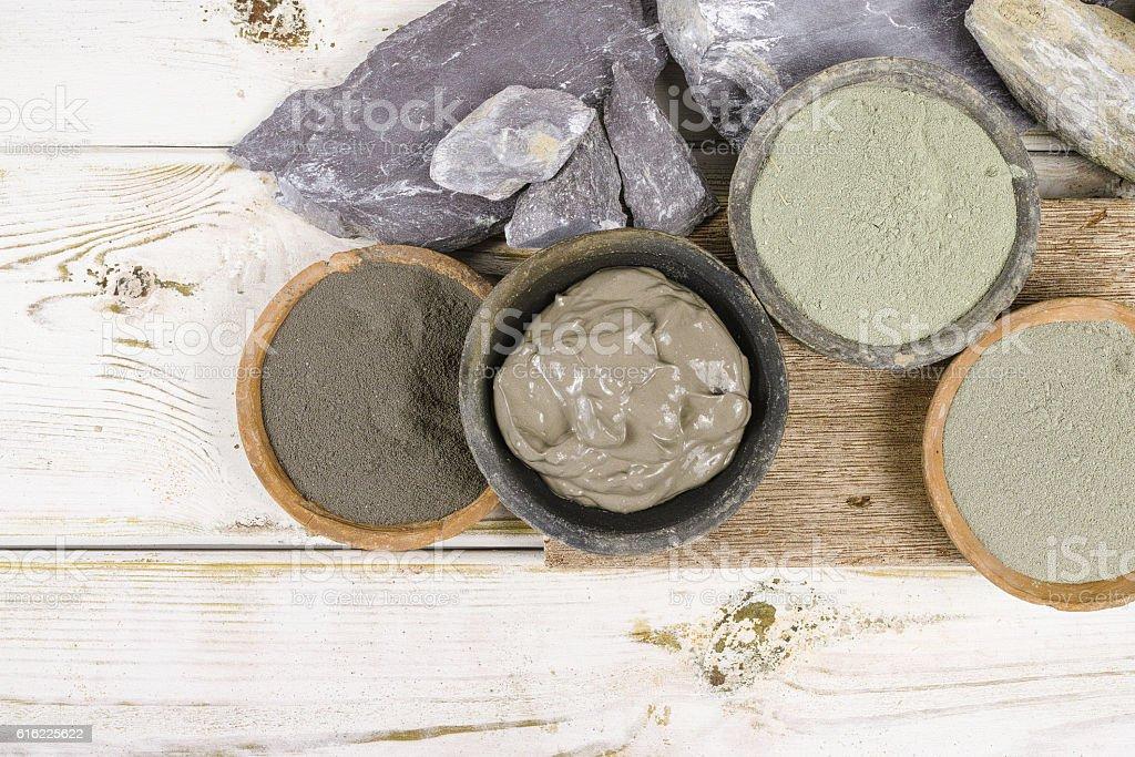 Ancient minerals - ochre, green, blue clay powder, mud mask stock photo